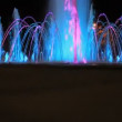 Girl with red balloon at light fountain — Stock Video #33354615