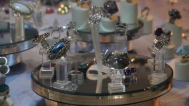 Jewelry on a rotating podium in the show — Stock Video