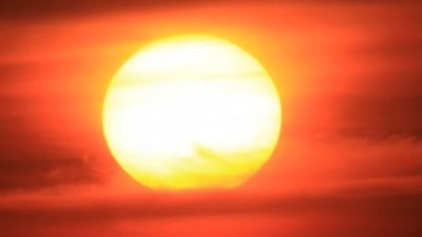 Bright big sun disk sunset in clouds sky — Stock Video