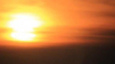 Yellow sun disk sunrise throught light clouds — Stock video