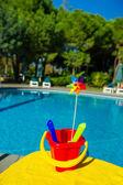 Plastic toys near swimming pool — Stock Photo