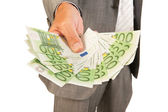 Business man giving euros — Stock Photo