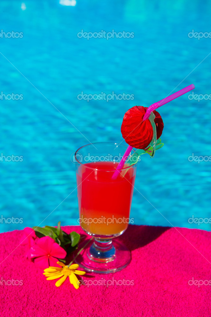 Glass cocktail drink at the luxury outdoor swimming pool    #12865645