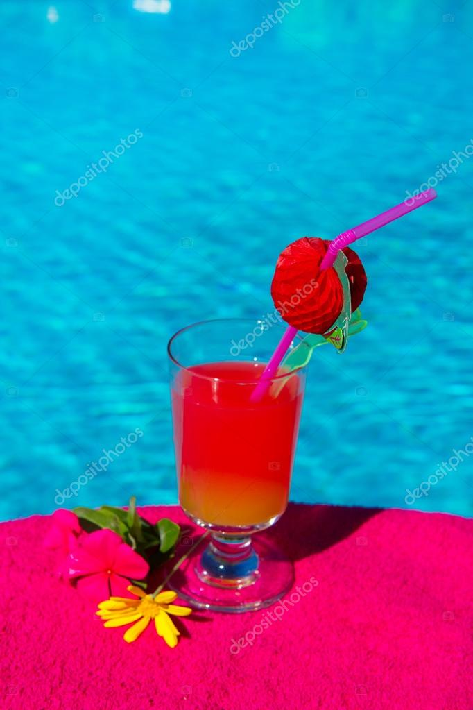 Glass cocktail drink at the luxury outdoor swimming pool  Foto de Stock   #12865645