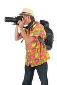 Tourist with camera and backpack — Stock Photo