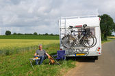 Man with camper in landscape — Stock Photo