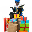 Dutch black pete with many presents — Stock Photo #14224855