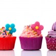 Colorful cupcakes with flowers — Stock Photo #14224939