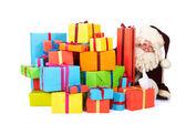 Santa Claus with many presents — Stock Photo