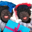 Stock Photo: Dutch black petes with presents