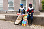 Dutch black Petes with presents — Stock Photo