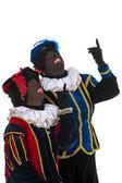 Dutch black petes pointing — Stock Photo