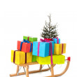 Sled with many Chirstmas presents — Stock Photo