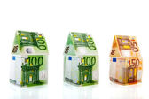 Money houses in a row — Stock Photo