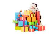 Santa claus met presenteert — Stockfoto