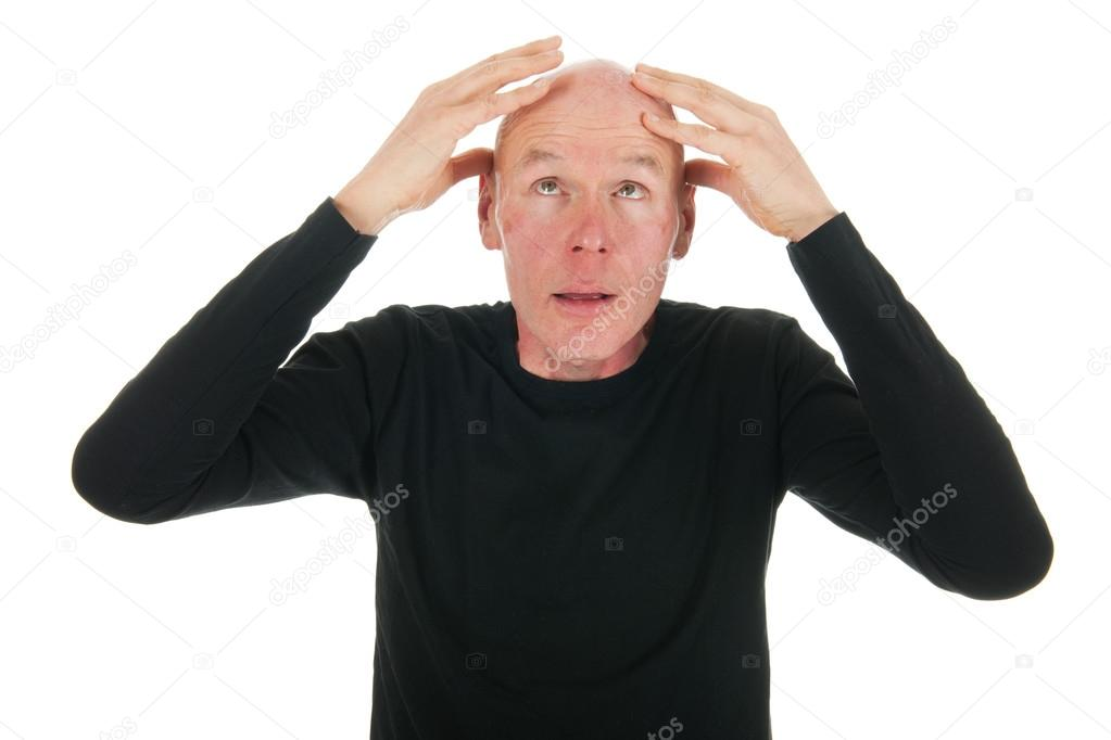 Man is looking to his bald head — Stock Photo #15610587