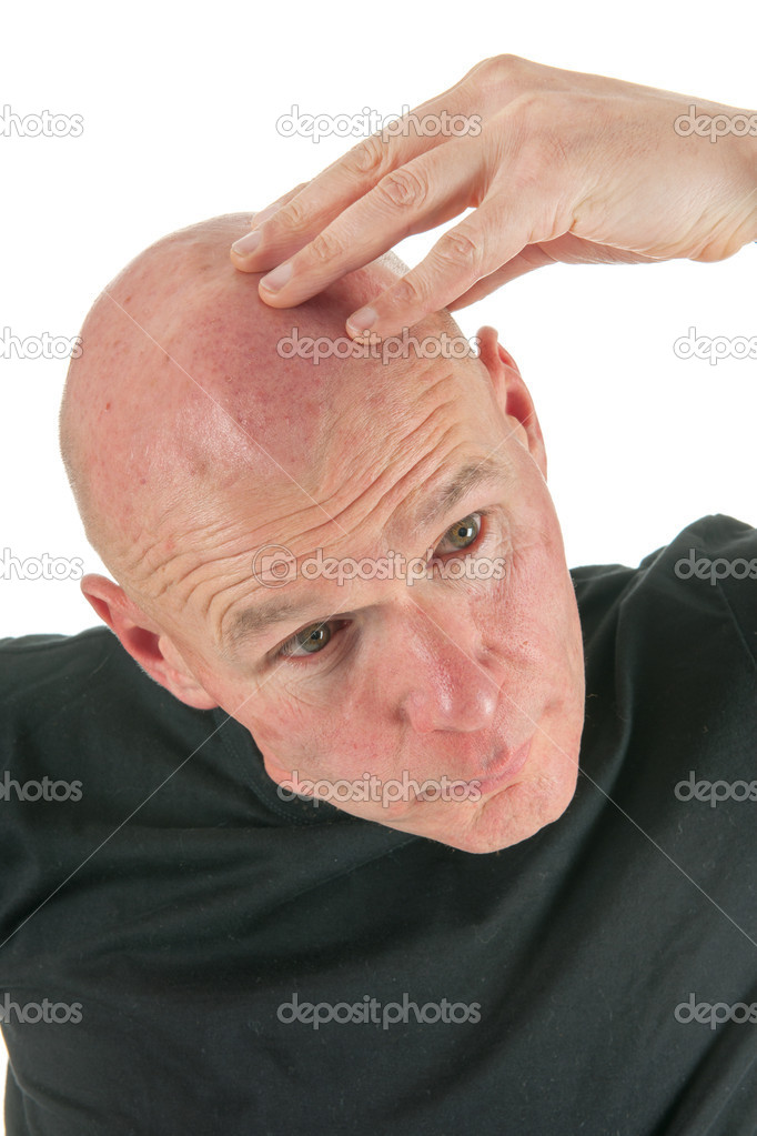Man is looking to his bald head — Stock Photo #15610601