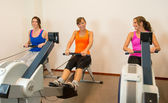 Rowing exercise in the sportclub — Stock Photo