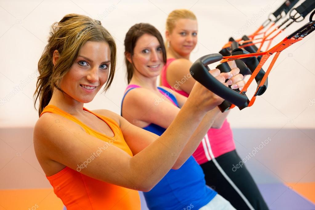 Girls are doing suspension training in the sports club — Stok fotoğraf #16291505