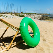 Empty beach chair with toys — Stock Photo