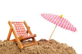 Beach chair and parasol — Stock Photo
