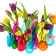 Colorful tulips in glass vases — Stock Photo