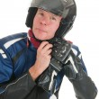 Stock Photo: Portrait motor biker putting on his helmet