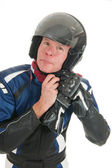 Portrait motor biker putting on his helmet — Stock Photo