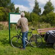 Reading the route map by biker — Stock Photo