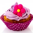 Pink cupcake with flower — Stock Photo