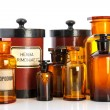 Apothecary pots with ingredients for medicins — Stock Photo