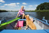 Man in boat at the river — Stock Photo