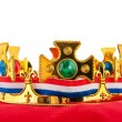Royalty-Free Stock Photo: Golden crown on velvet pillow with Dutch flag