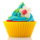 Birthday cupcake with flower — Stock Photo