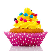 Birthday cupcake with confetti — Stock Photo