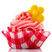 Red cupcake with yellow flower — Stock Photo