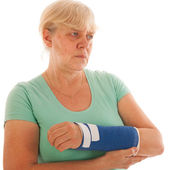 Old woman with broken wrist in gypsum — Stock Photo