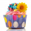Pink cupcake with flower and letters — Stock Photo