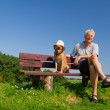 Man and dog with hat — Stock Photo #24943613