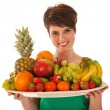 Pretty woman with fresh fruit — Stock Photo