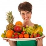 Pretty woman with fresh fruit — Stock Photo