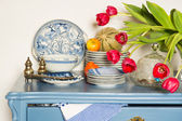 Lavender colored cabinet with antique — Stock Photo