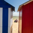Mon beach in front of beach huts — Stock Photo #28715393