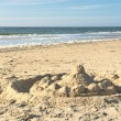 Stock Photo: Sand castle at Texel beach