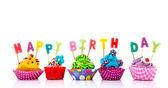 Colorful Happy birthday cupcakes — Stock Photo