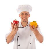 Cook with fresh paprikas — Stock Photo