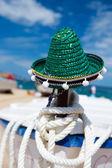 Green Spanish straw hat at beach — Stock Photo