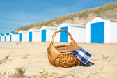 Picnic at beach with Blue huts — Stock Photo