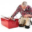Stock Photo: Senior manual workersolder metal