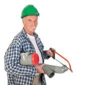 Plumber sawing PVC — Stock Photo